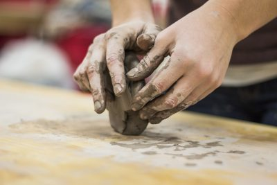hands shaping clay