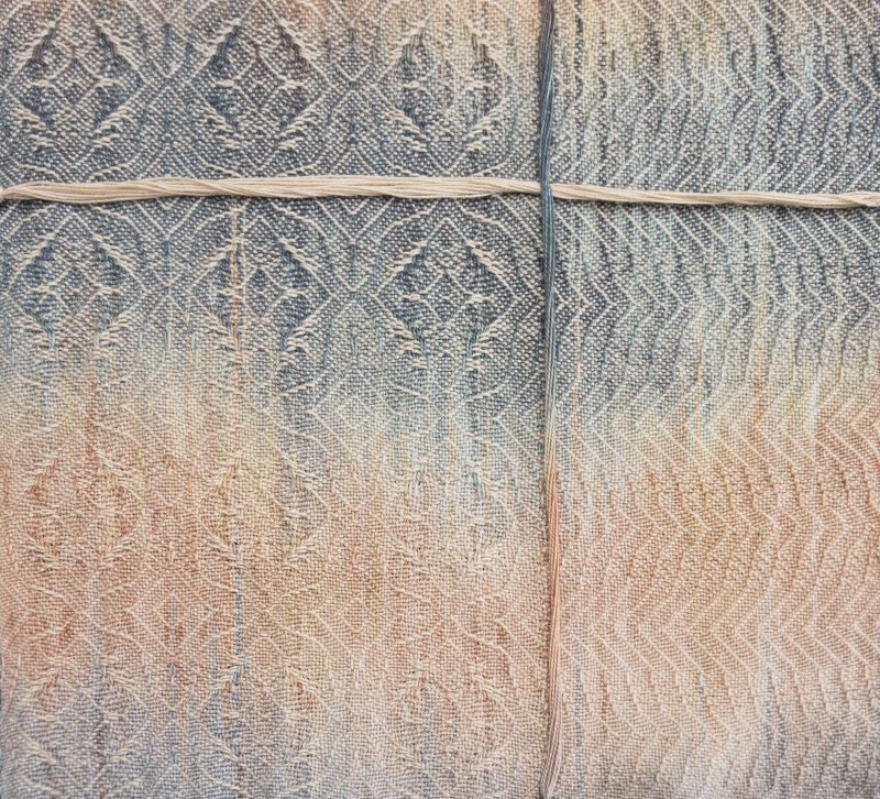 painted warp sample blended with a neutral color weft