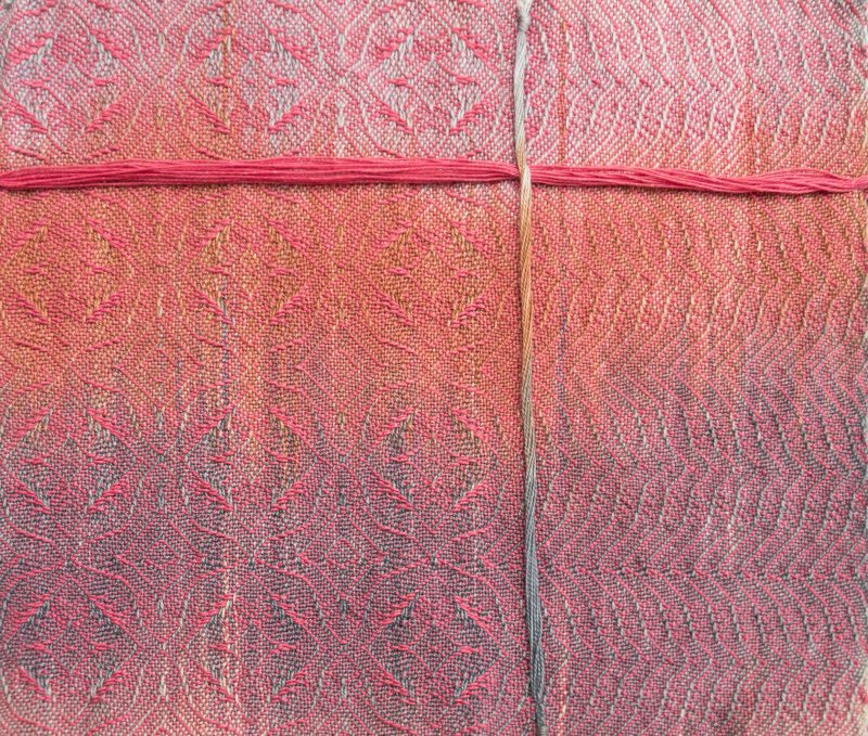 painted warp sample woven with a soft pink weft