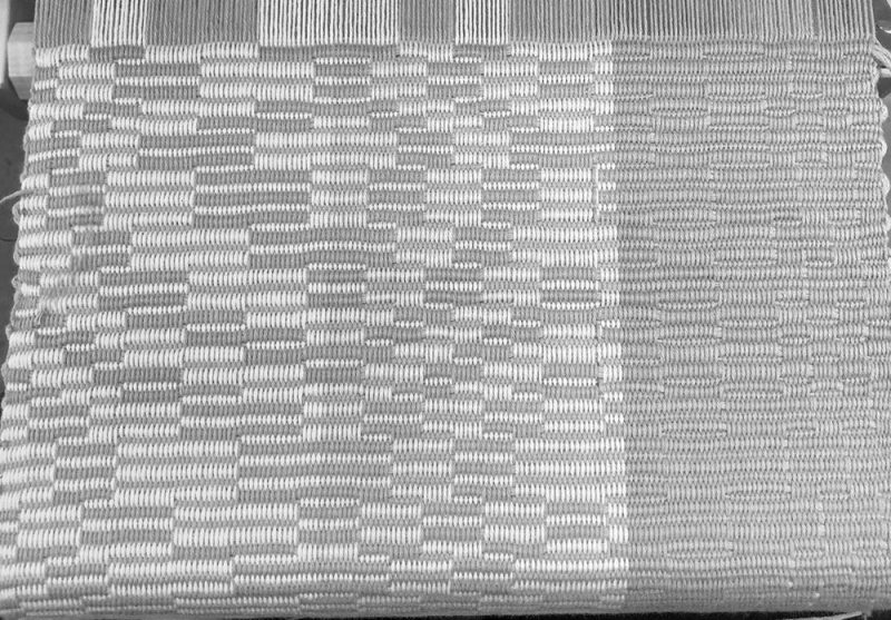 Handwoven repp weave sample, seen in black and white