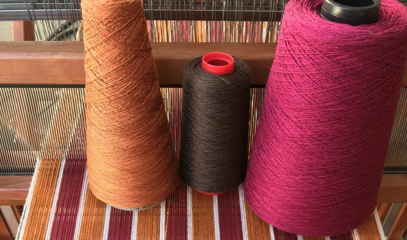 burgundy, gold, and brown yarns in color