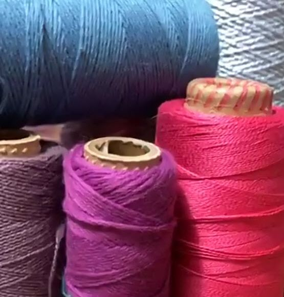 Four weft yarns: dull purple, orchid purple, screaming pink, and dull blue