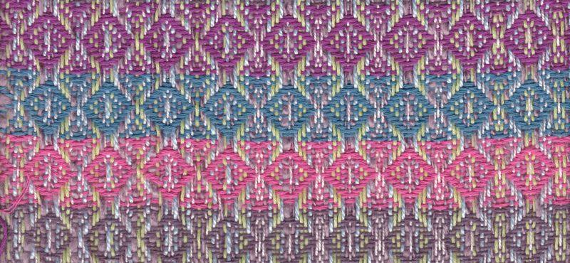 swatch with four equal stripes of each weft color