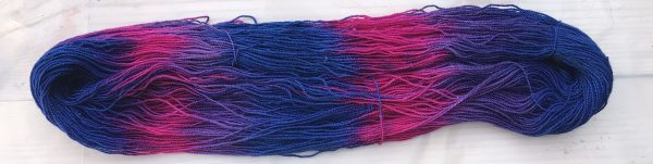 Painted skein in purples, blue, and magenta - colors that follow the Two primary Rule