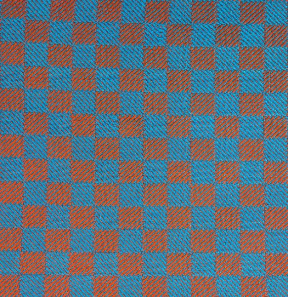 1/3 vs. 3/1 twill blocks swatch woven in blue and orange yarns, with brightly colored patches
